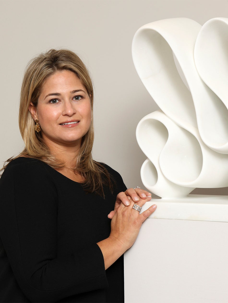 Liz stands with a white-marble sculpture by Elizabeth Turk, one of 20-plus contemporary artists represented by the gallery.