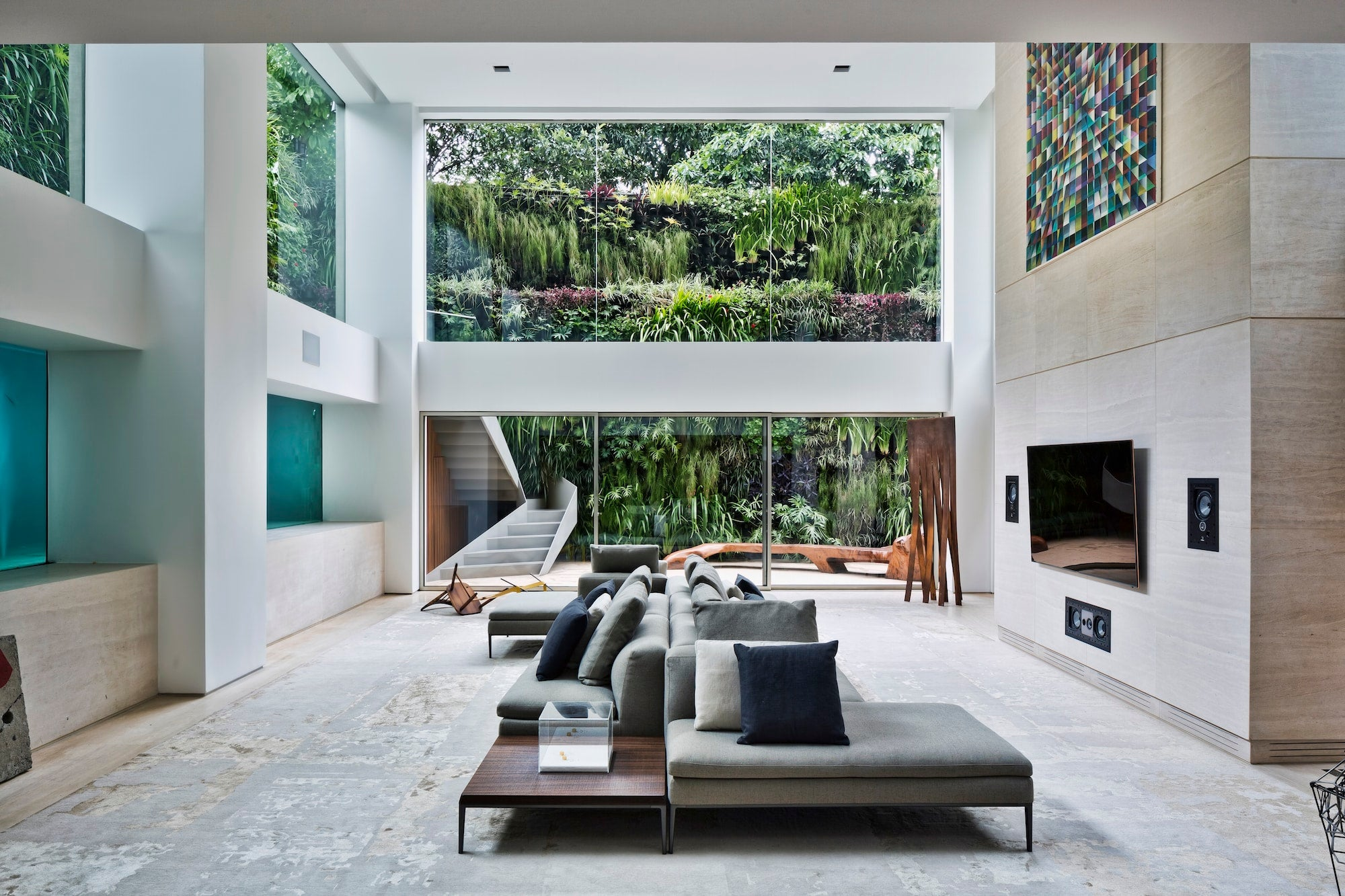 Fernanda Marquess Design For The Double Height Living Room Of Sao Paulo Duplex Includes Thick Glass Panels Revealing Swimming Pool