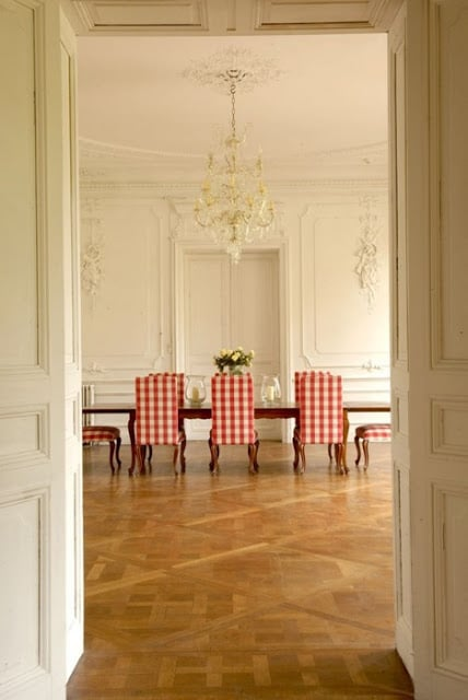 note to this grandly proportioned boiserie covered dining room