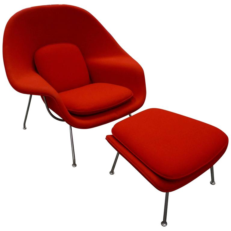 red arm chair and ottoman