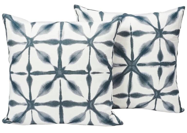 Schumacher's Andromeda pillows have a shibori-style pattern indigo white linen.