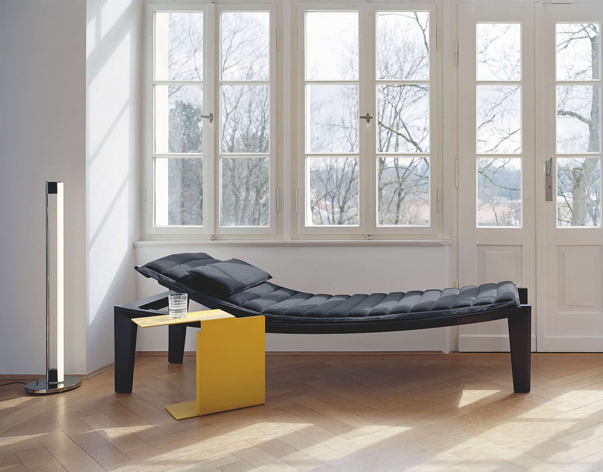 Konstantin Grcic's Ulisse daybed and Diana A side table accompanied by Eileen Gray's Tube light, 1927