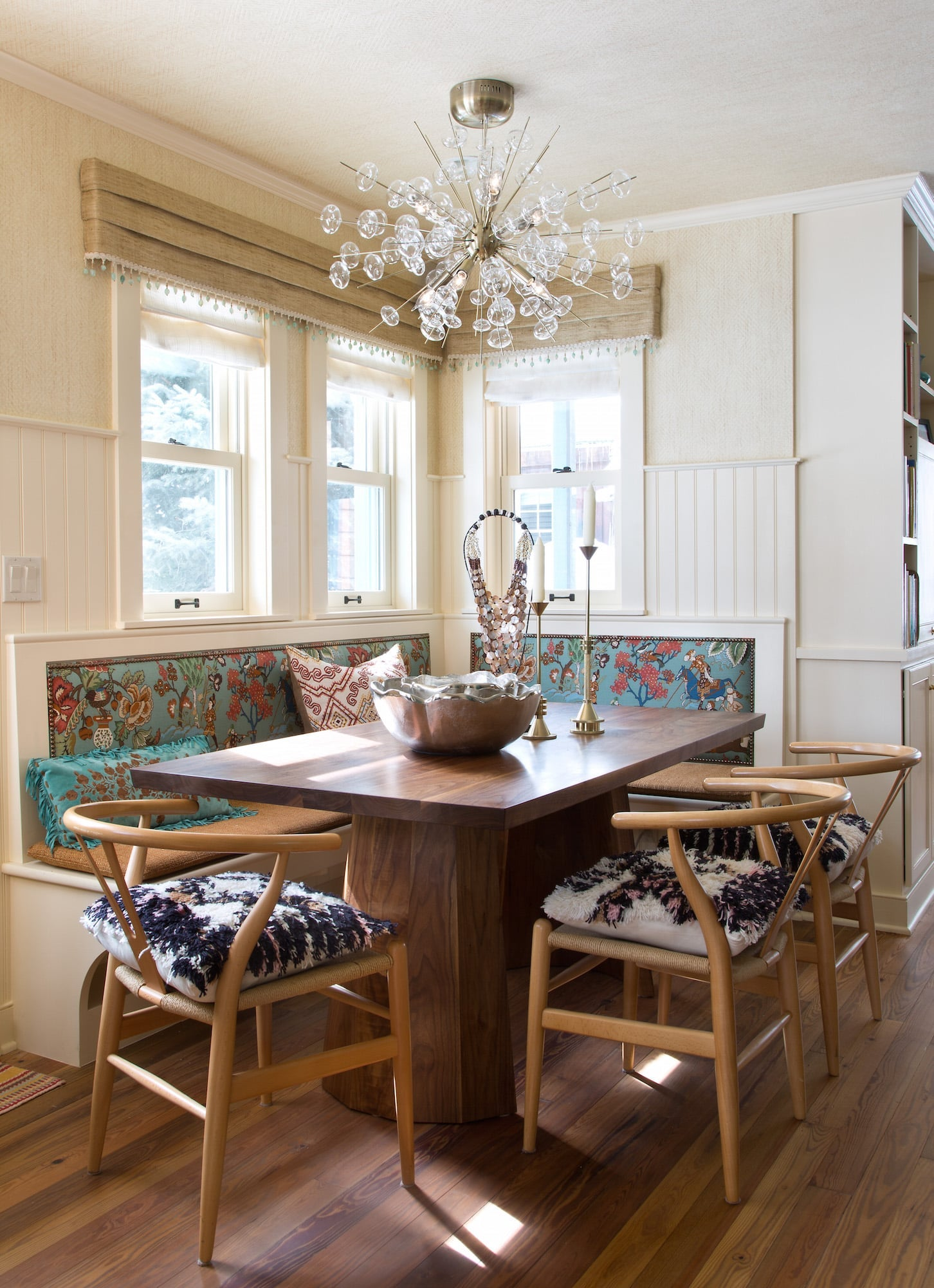 For a dining space in Crested Butte, Colorado, the designer upholstered a banquette in Hurlingham fabric from Cowtan & Tout and wrapped the space — even the ceiling — with Phillip Jefferies' Diamond Weave grass-cloth wallcovering in Richmond Bisque. Photo by Emily Minton Redfield