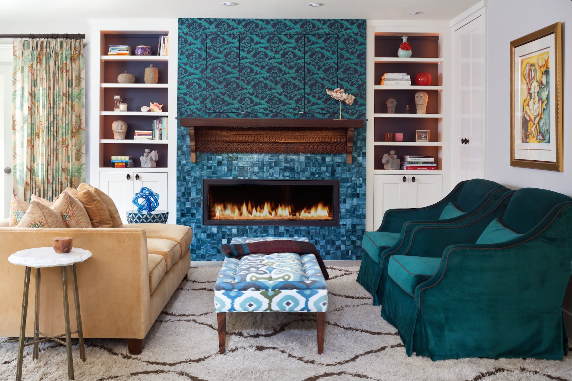 A Phillip Jeffries wallpaper helps to make the hearth a conversation starter. Carleton V's Puff drapery fabric and a Tibetan Wave shag rug from David E. Adler lend quieter patterns in the background. Photo by Emily Minton Redfield