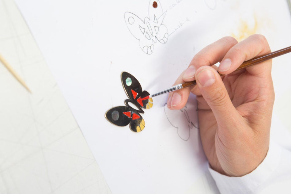 Butterfly pendant being painted