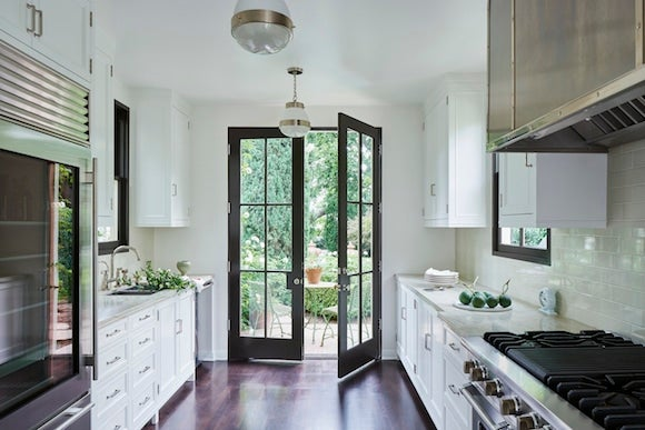 30 incredibly stylish kitchen designs madeline stuart punctuated the bright galley kitchen of this hollywood hills home with black trim on the windows and french doors freerunsca Choice Image