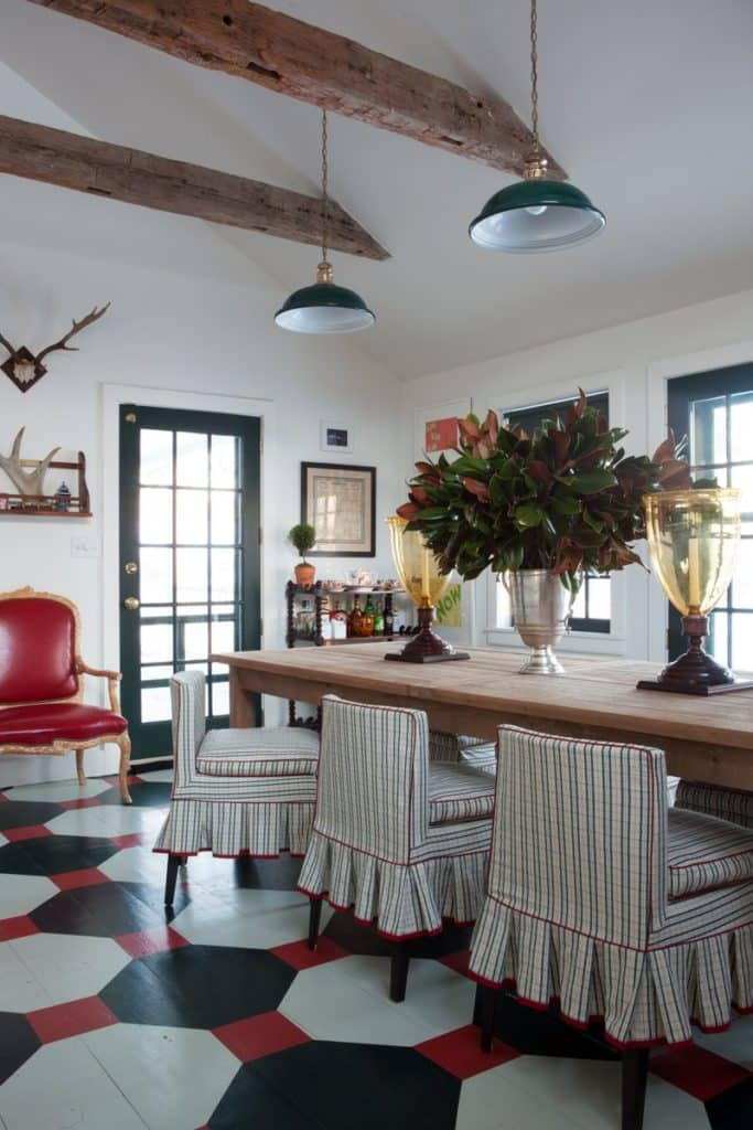 Painted wide-plank wood floors are an unexpected feature of this Nick Olsen–designed colonial in Dutchess County, New York.