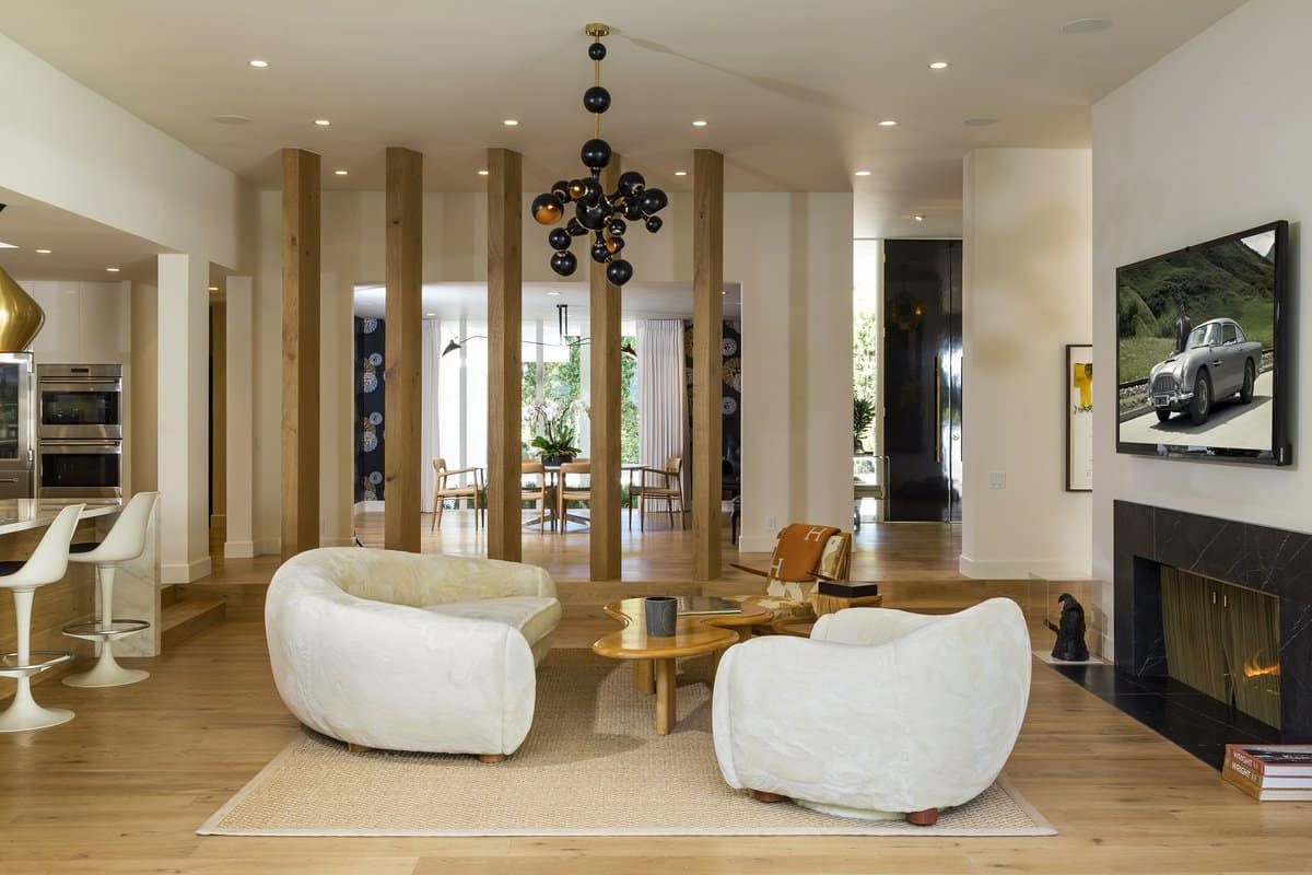 Round furniture provides visual interest in this Beverly Hills living room by Trip Haenisch. Photo by Beryln Photography