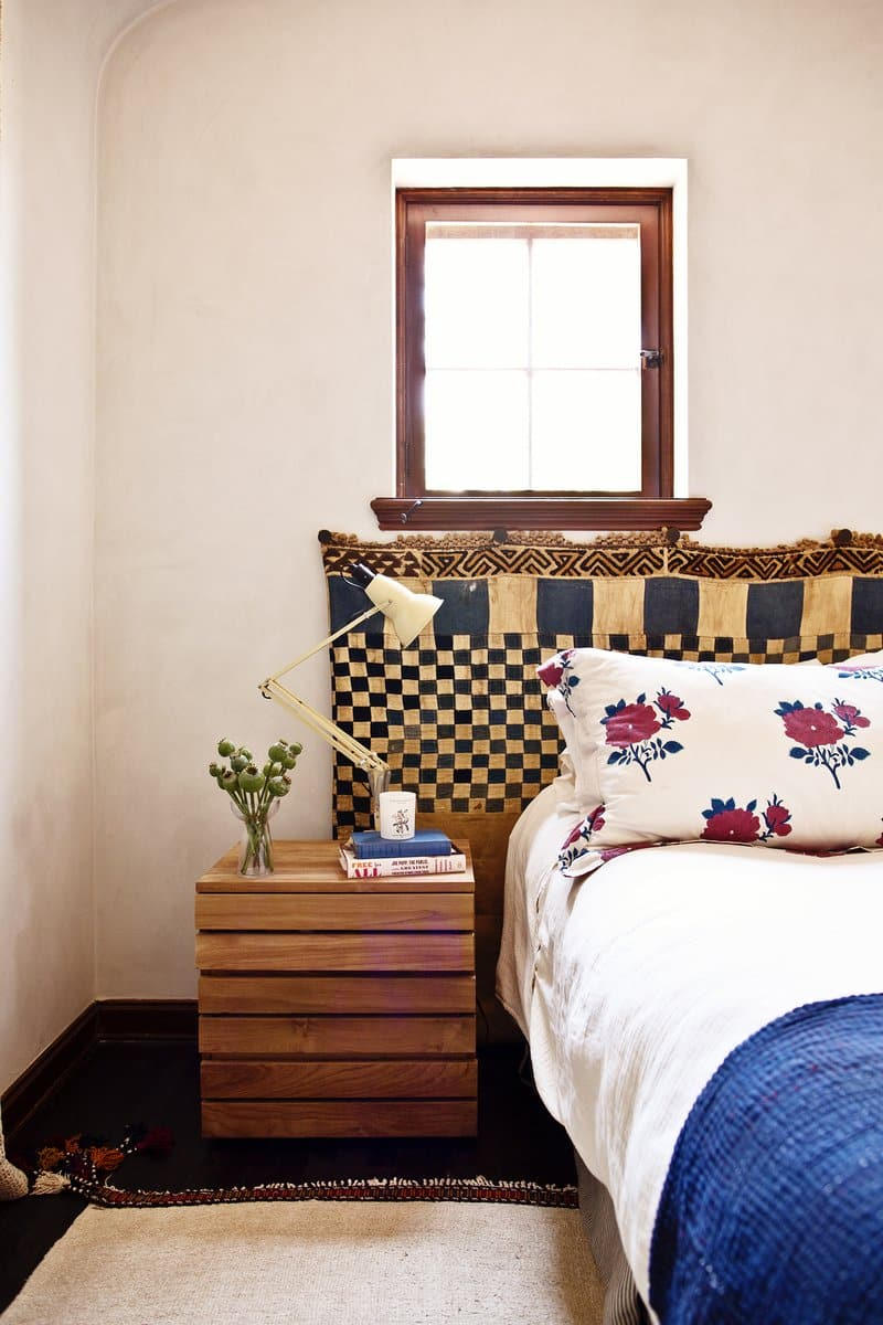 A mud-cloth-style textile serves as a headboard in a Los Angeles bedroom decorated by Reath Design.