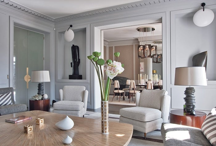 Architect and designer Jean Louis Denoit calls the living room of this Paris  pied terre an ode to gray Image by Xavier Bejot courtesy Rizzoli Parisian Interior Design 16 Images Chic Apartments Style