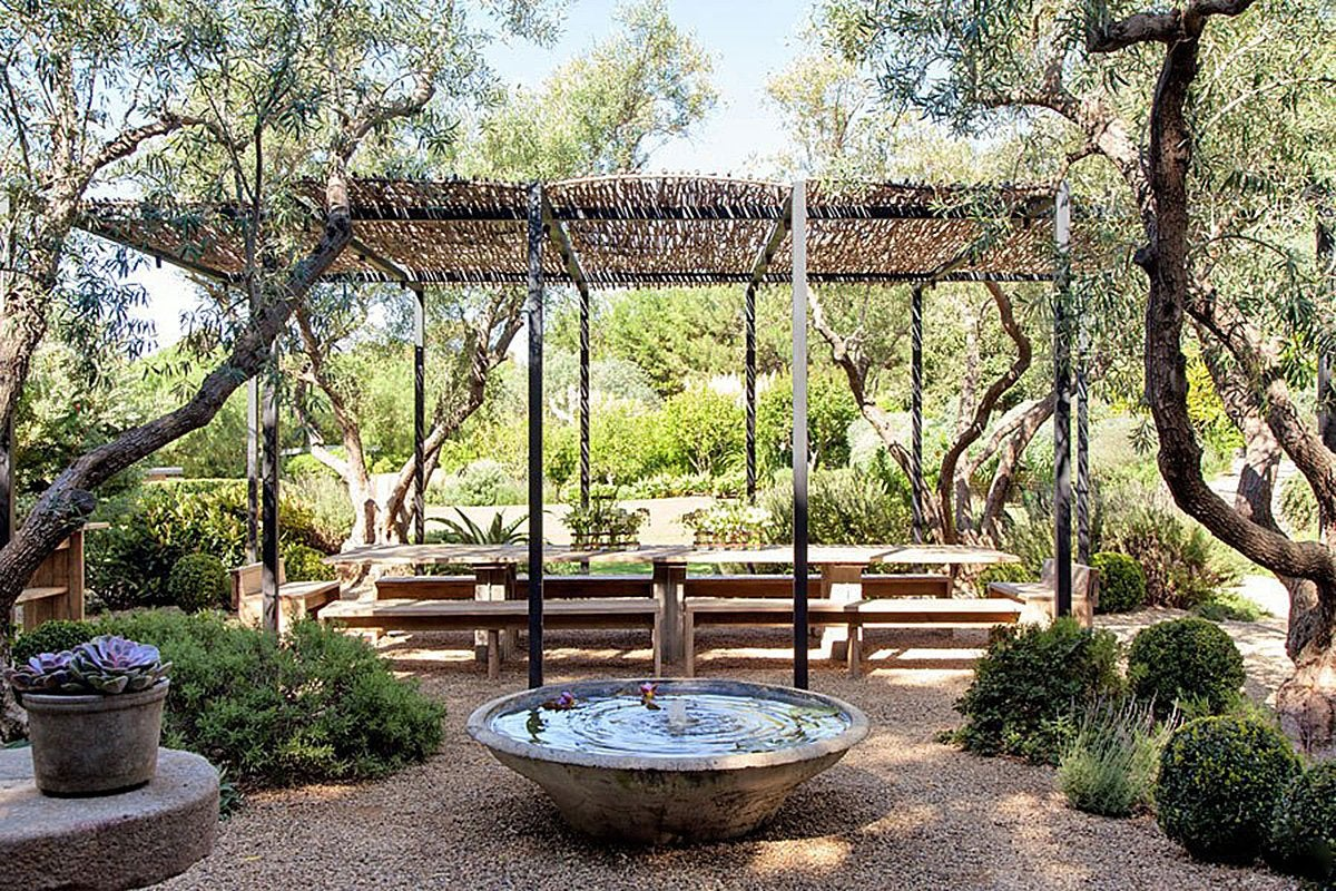 The outdoor dining space of Patrick Dempsey's Malibu family house with revamped interiors by Estee Stanley of Hancock Design.