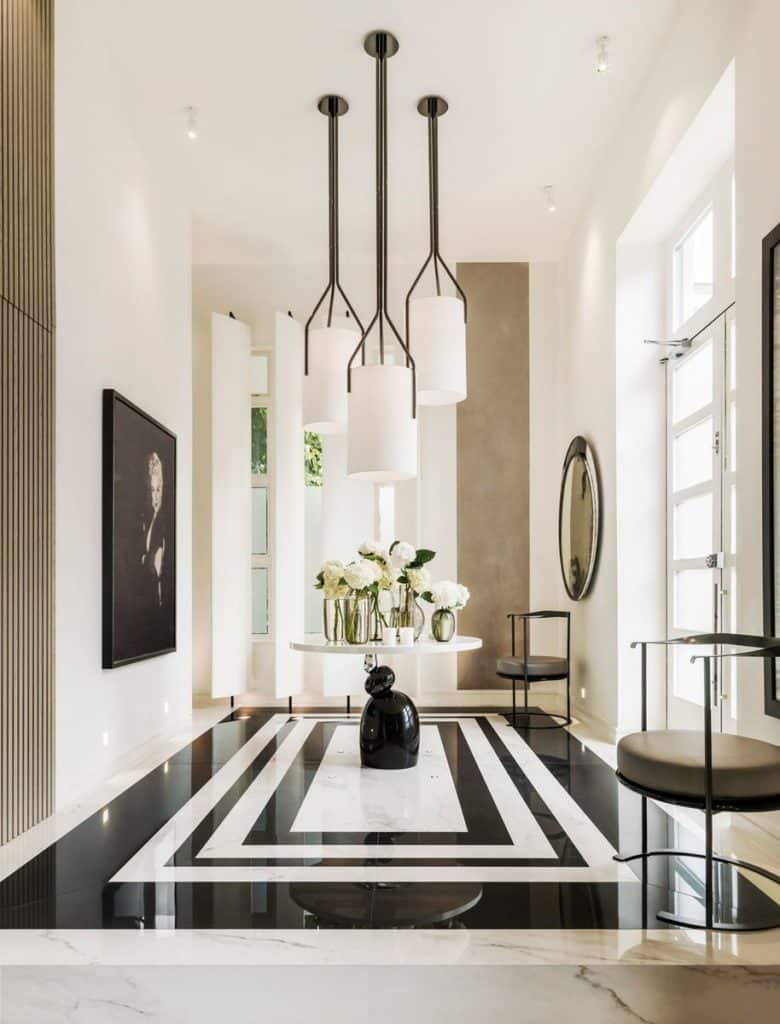A black and white marble floor sets a dramatic tone in the foyer of Kelly Hoppen's London home.