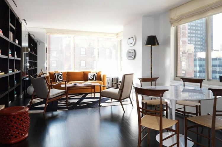 In this manhattan high rise mishaan employed a teak framed nv 45 chair by finn juhl to evoke a seductive mid century mood photo courtesy of the monacelli