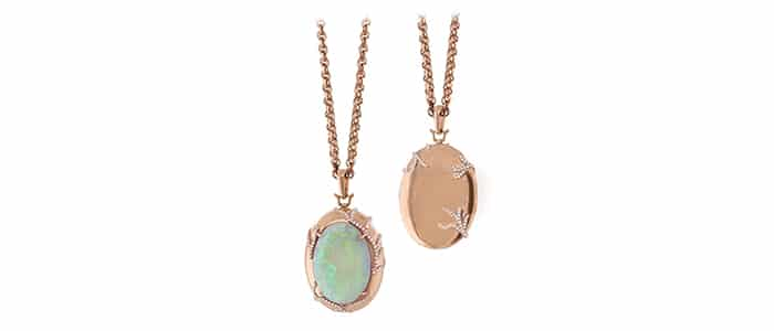 An opal, diamond and rose gold locket by Rich Kosann.