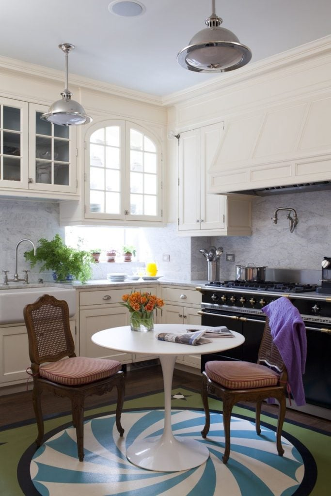 An Eero Saarinen Tulip table stands at the center of the swirl-patterned floor in this Park Avenue kitchen by Brockschmidt & Coleman.