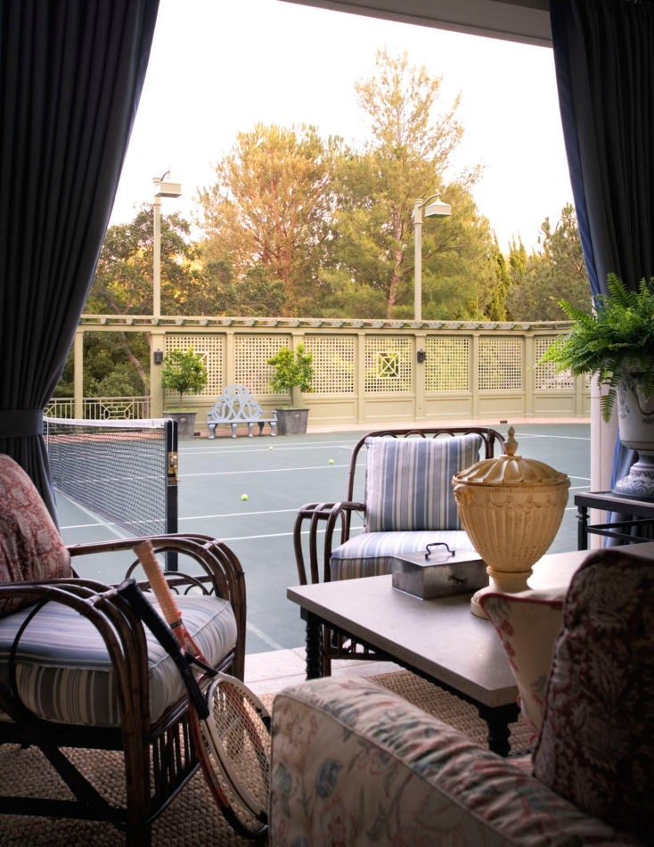 Tented seating area on a tennis court in Los Angeles, designed by Michael S. Smith