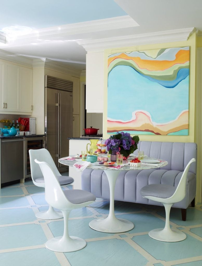This Manhattan kitchen by Celerie Kemble has a strong Palm Beach vibe, anchored by the hand-painted floor.
