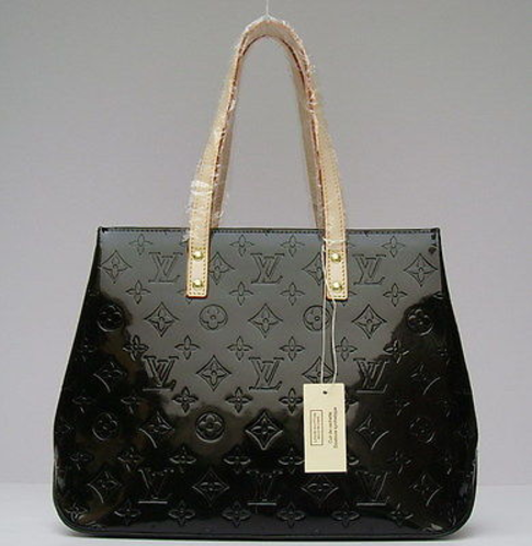 c8de7e00e44e A real Louis Vuitton comes into the world unembellished. Hang tags and  plastic wrap are a sign to walk away. Photo via eBay