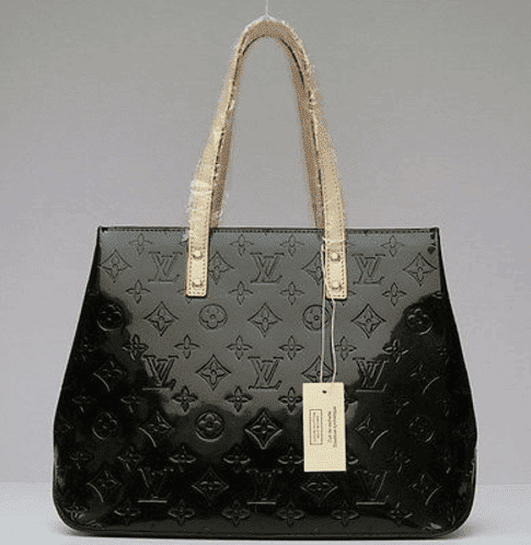 be20cb3db A real Louis Vuitton comes into the world unembellished. Hang tags and  plastic wrap are a sign to walk away. Photo via eBay