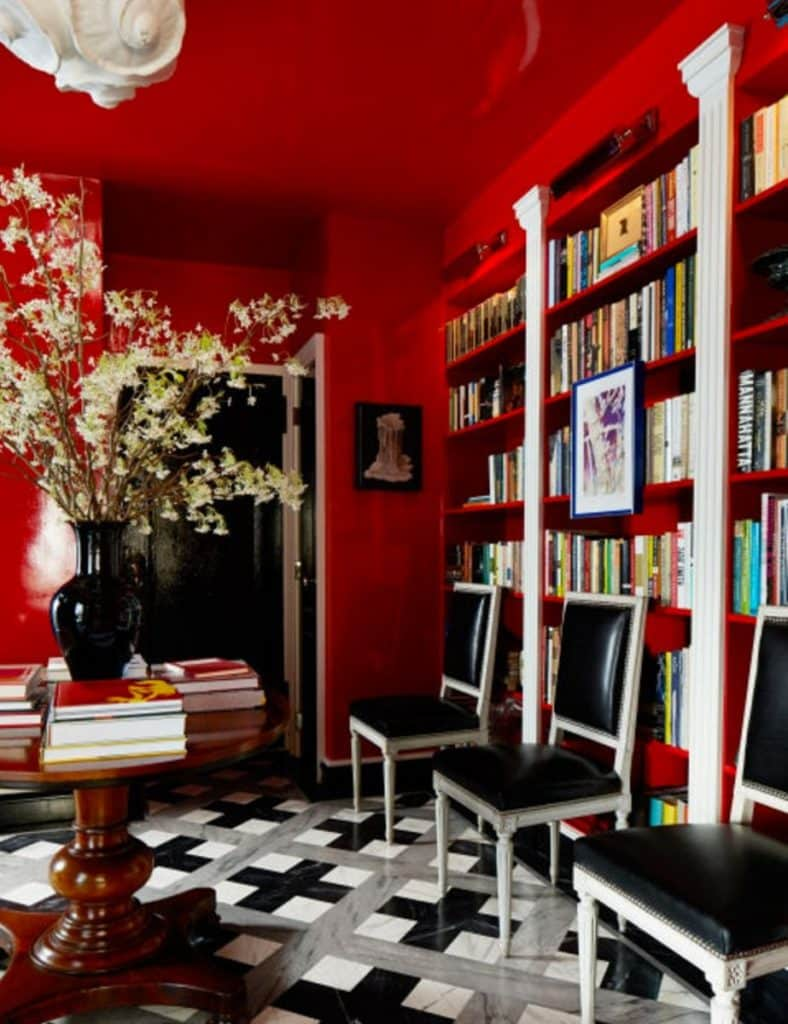 The red-lacquered walls and ceiling of this Nick Olsen–designed West Village apartment pop against the grey, white and black marble floor.