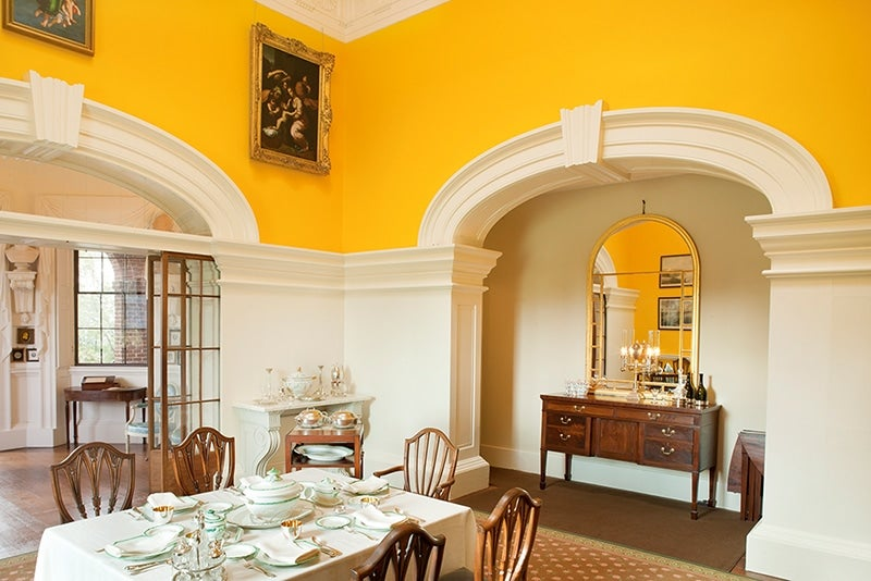 The bright yellow walls of monticellos dining room reveal jeffersons affinity for then avant