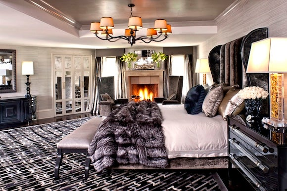 The irregular shape of this master bedroom led me to create a number of  large custom pieces, including the bed, says designer Jeff Andrews.