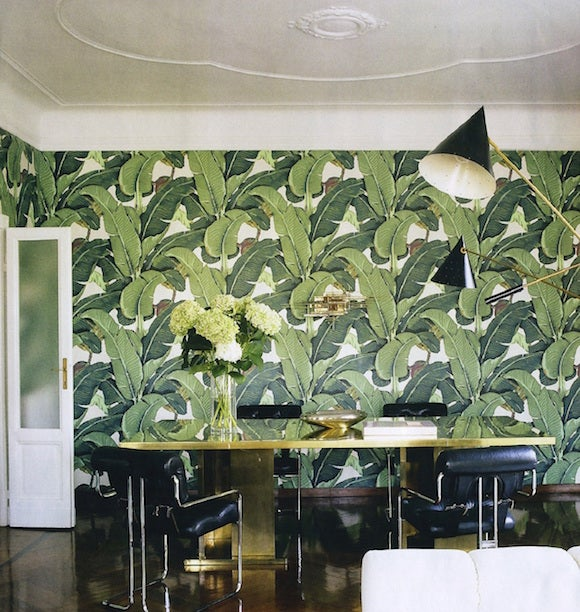 Nate Berkus chose Martinique's iconic banana leaf-print wallpaper for the dining room of this apartment in Milan. A set of black leather Pace Collection ...