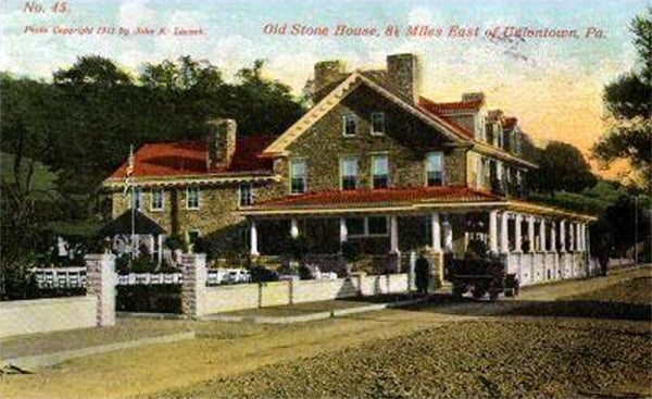 The historical Stone House, as depicted in a 1910 photograph.