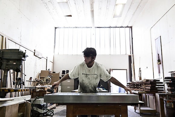 Roeper working on his Divided Lands coffee table in his atelier.