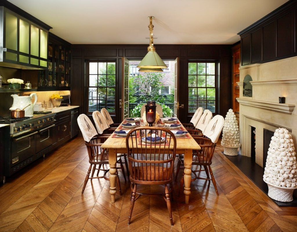 Herringbone wood floors add warmth to this kitchen in a townhouse by Kirsten Kelli on New York's Upper East Side.