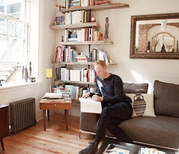 John Sorensen Jolink In His Brooklyn Living Room With A Hover Shelving Unit  Custom Made By His Company Coil + Drift And A Vase Pillow By Amelie Mancini.