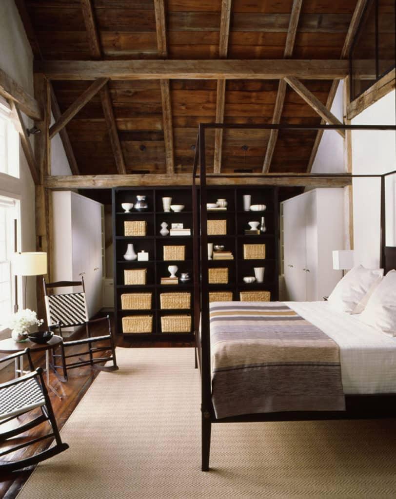 In This Bedroom, Streamlined Dark Wood Furniture Is Juxtaposed With Rustic  Elements Like Distressed Wood Beams ...