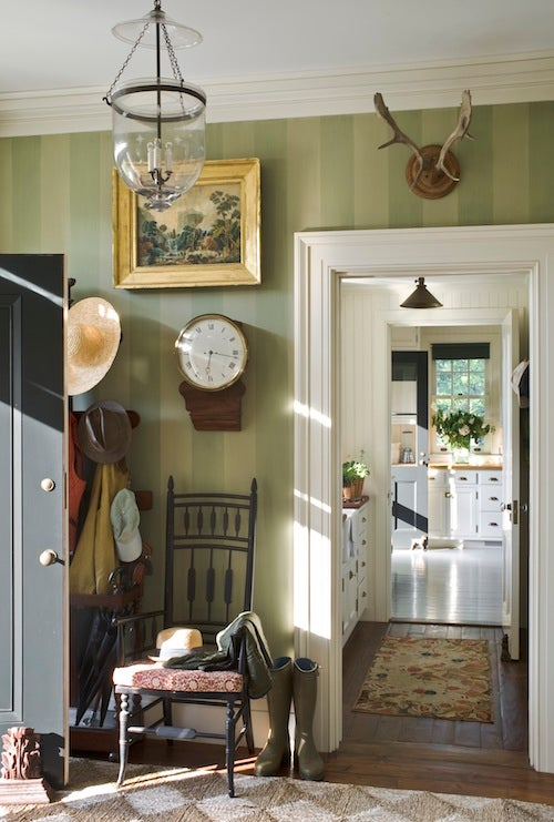 The Entryway Of GP Schafers Home In New Yorks Hudson Valley Features A 19th Century Clock Which Chimes On Hour Pair Antlers And Victorian