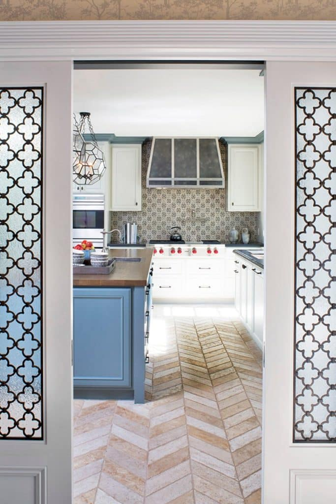 For this 1937 Federal-style home in Los Angeles, Annette English combined several smaller rooms to create a large, open kitchen, with herringbone travertine flooring.