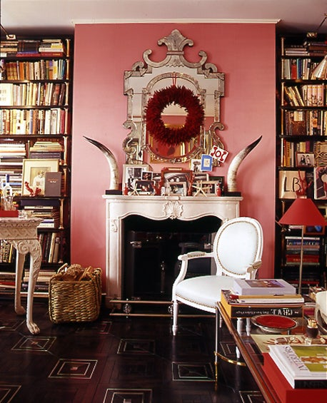 Interior designer Miles Redd's eclectic style is on full display in his Manhattan home, where he has paired a plush red sofa with a pink wall covered in ...