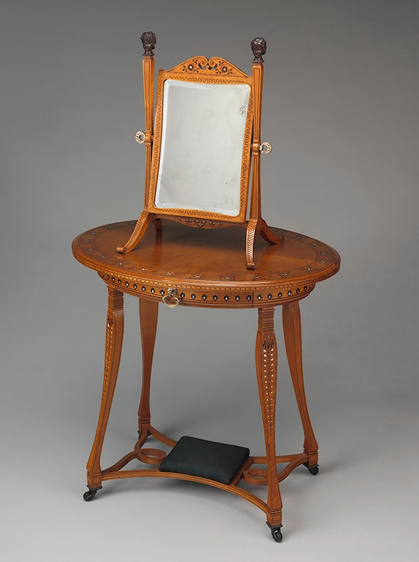 A dressing glass Schastey created for the dressing room includes mother-of-pearl and brass detailing, while the room's Schastey-designed dressing table still features its original upholstery.