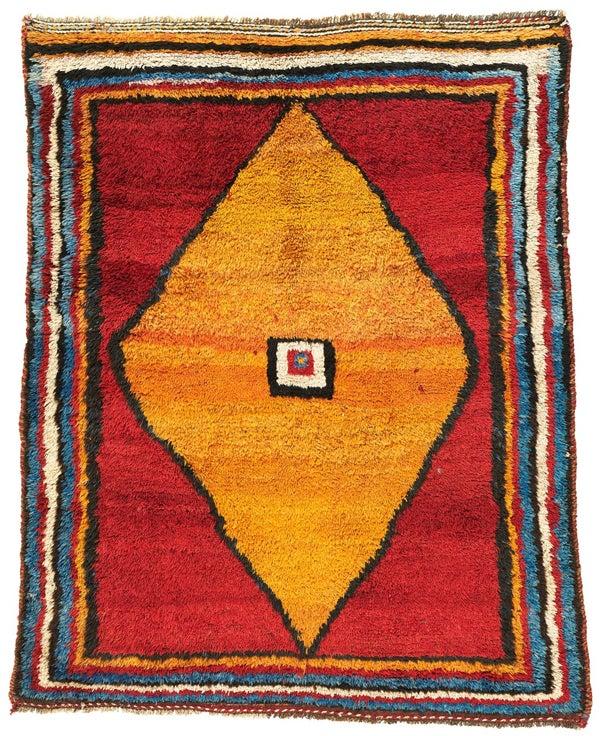 A circa-1900 Gabbeh rug.