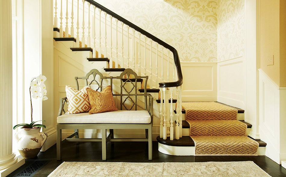 For the Westwood project, Goldberg combined the natural look of a sisal stair runner with stately Schumacher damask wallpaper.