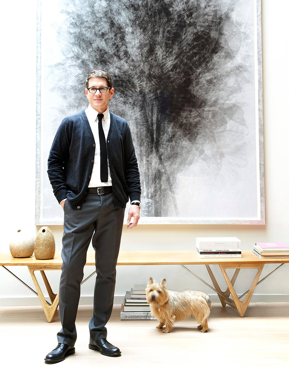 The designer, with his Norwich terrier, Harvey, stands in front of Idres Khan's Blossfeldt...After Karl Blossfeldt 'Art Forms in Nature', 2005, purchased from San Francisco's Fraenkel Gallery.
