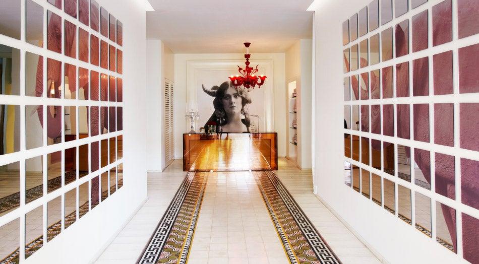 A hallway at yoopune displays Starck's sense of drama.