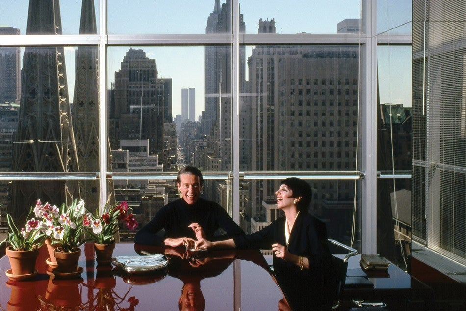 In the mid-1970s, signaling the growing prominence of the brand, Halston relocated his offices from a crowded brownstone to the 21st floor of the Olympic Tower on Fifth Avenue, overlooking St. Patrick's Cathedral; he's seen here in 1978 with close friend Liza Minelli.