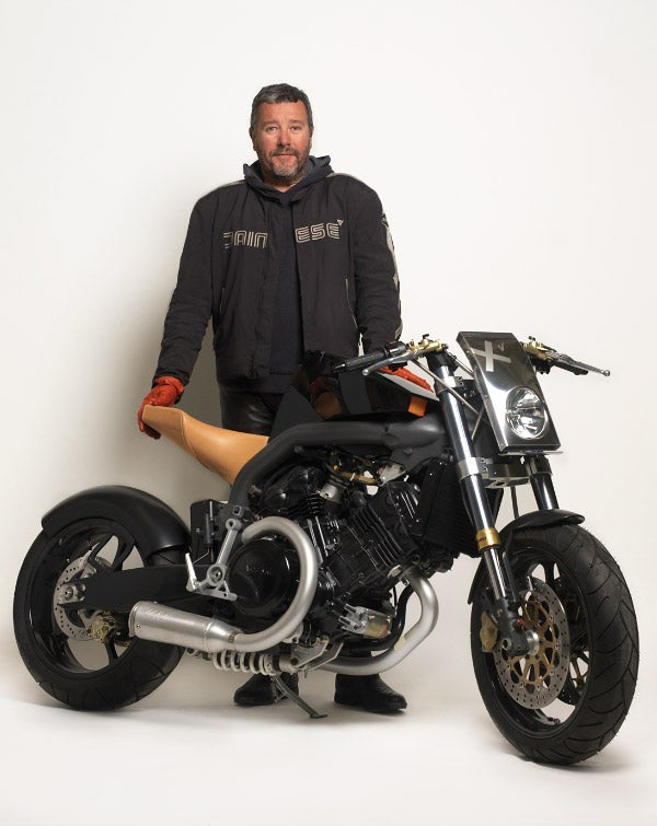 Starck poses with the Super Naked Xv, Voxan by Starck. Photo by Thomas Duval