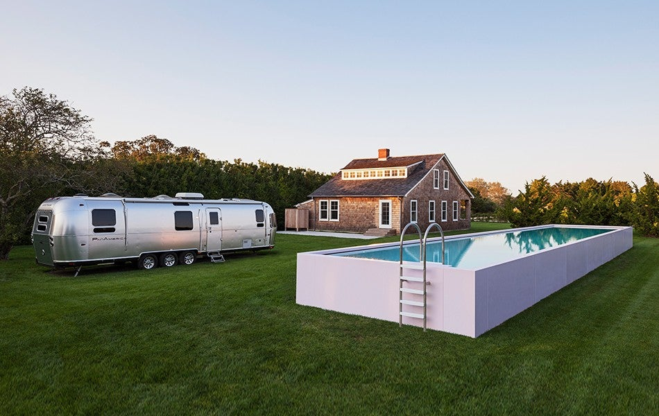 for one client who was downsizing from a 15000 square foot beach house he created a modest compound that includes an above ground pool in a pink corian