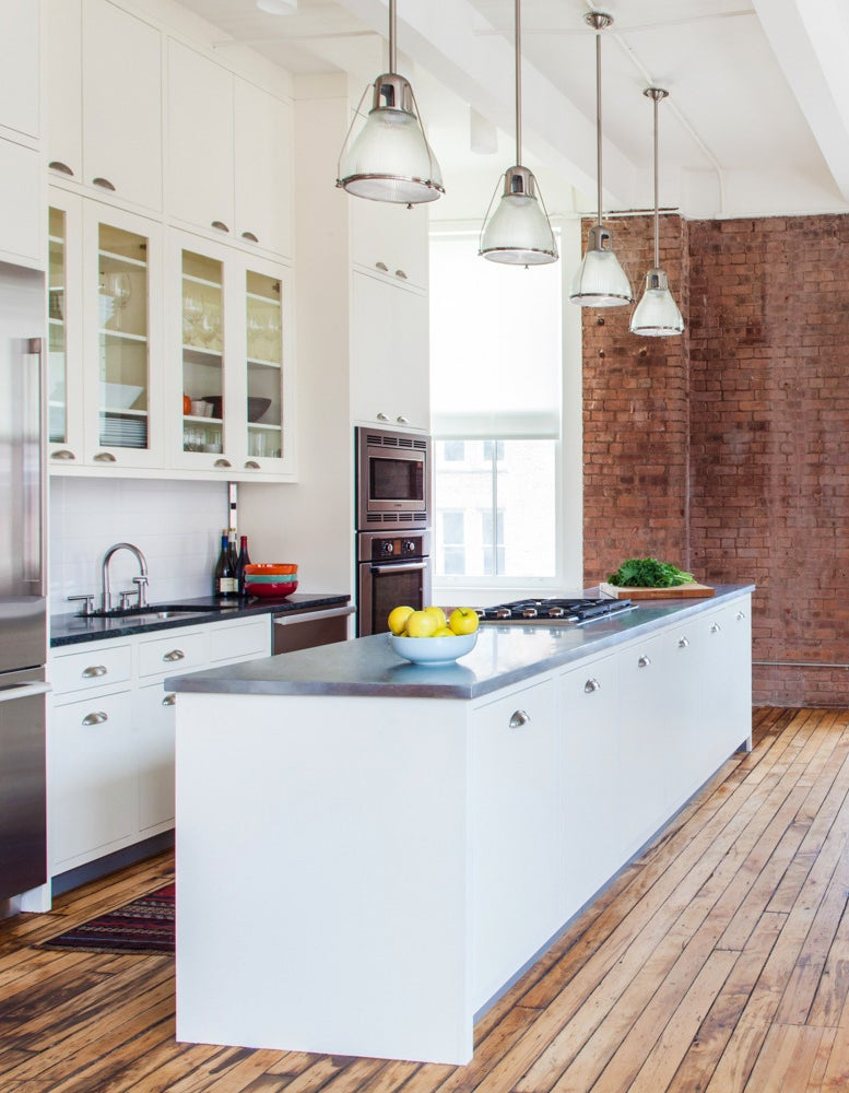 The revamped kitchen features floor-to-ceiling cabinets, soapstone counters and a zinc-top island. Photo by Brett Beyer, courtesy of Rumba