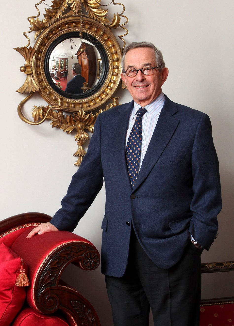 In his office, Stuart stands in front of one of a pair of girandole mirrors, made in Philadephia in 1810, with his hand resting on a circa 1826 sofa attributed to Isaac Vose of Boston.