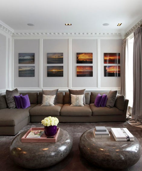 The couple's living room features a silk carpet, bespoke sofa and scagliola plaster coffee tables.