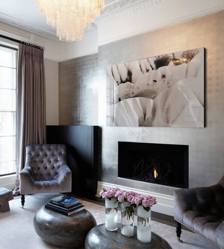 Barratt-Campbell signatures include luxurious textures and statement lighting pieces, both in evidence at her home, which features silk-velvet chairs and stools upholstered in embossed suede.
