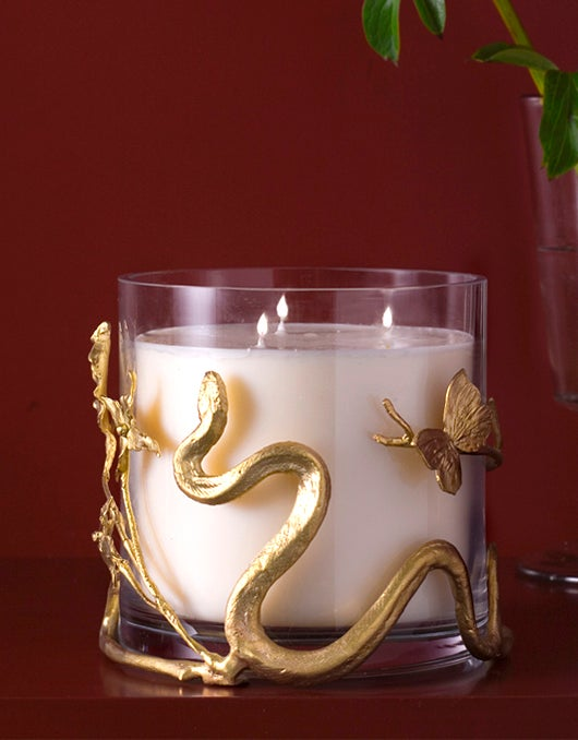 New York's Maison Gerard offers Claude's hand-chased bronze candleholder and honeysuckle candle