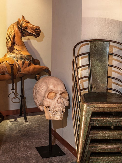 What would be unlikely juxtapositions elsewhere — an oversized Polyurethane sculpture of a skull, say, with a French 1890 carousel horse — are par for the course at Il Segno.