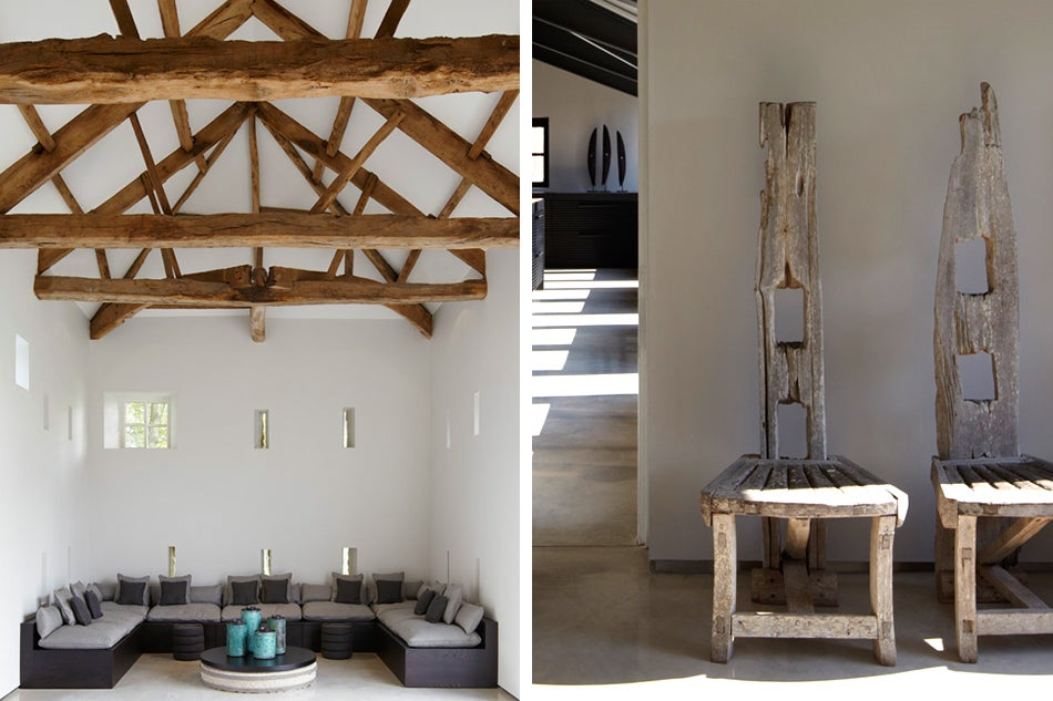 Left: A restrained palette with clean, structured lines further enhances the dramatic beamed architecture at this residence in Harrogate, Yorkshire; the base of the coffee table is made from an old mill stone found in the area. Right: Barratt-Campbell added chairs made of reclaimed driftwood — at once sculptural and earthy — to a residence in Yorkshire.